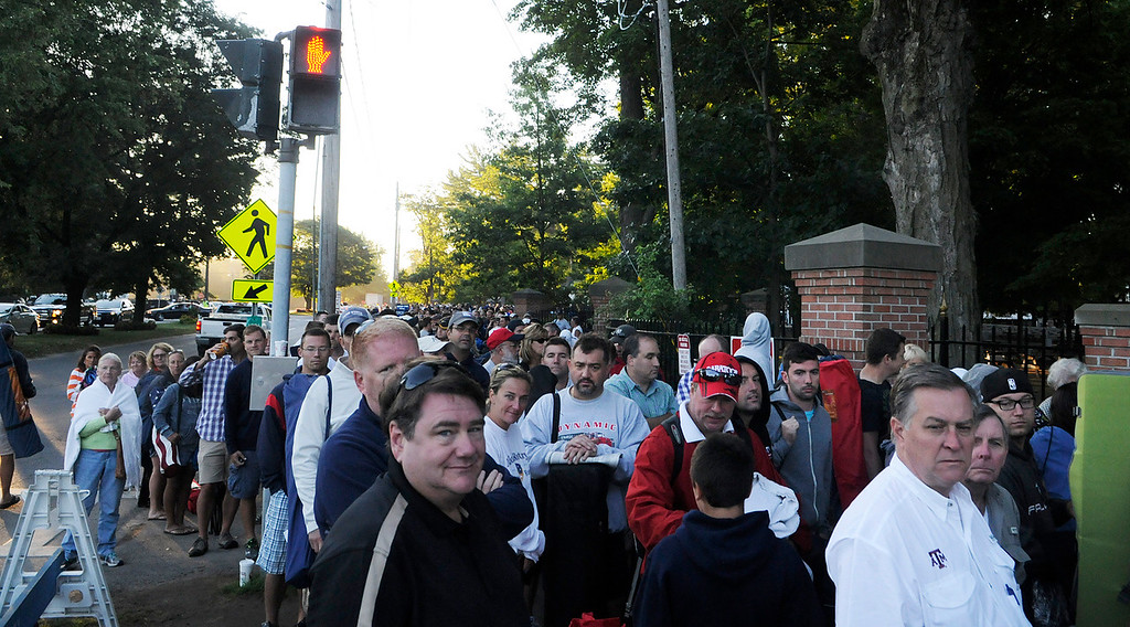 . A huge line is made on Union Ave outside the Saratoga Race Course entrance gate before the crowd is allowed to enter to line up at the main entrance.Photo Erica Miller/The Saratogian 8/24/13 news_TheMadDash1
