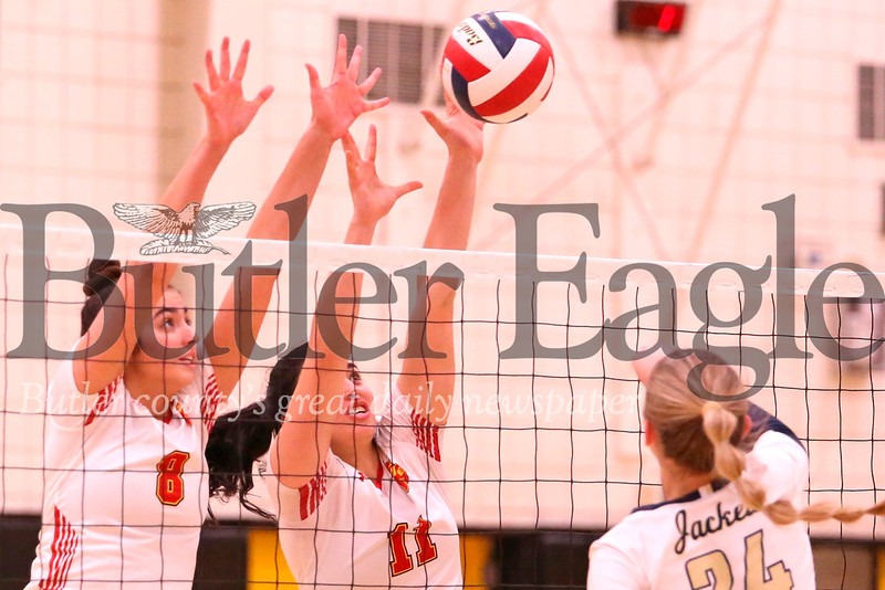 North Catholic's Dominique Felix (11) and Ava Whitesel (8) go for a block over Freeport's Isabella Russo during the Trojans' 2-0 playoff win Tuesday night at North Allegheny. Seb Foltz/Butler Eagle