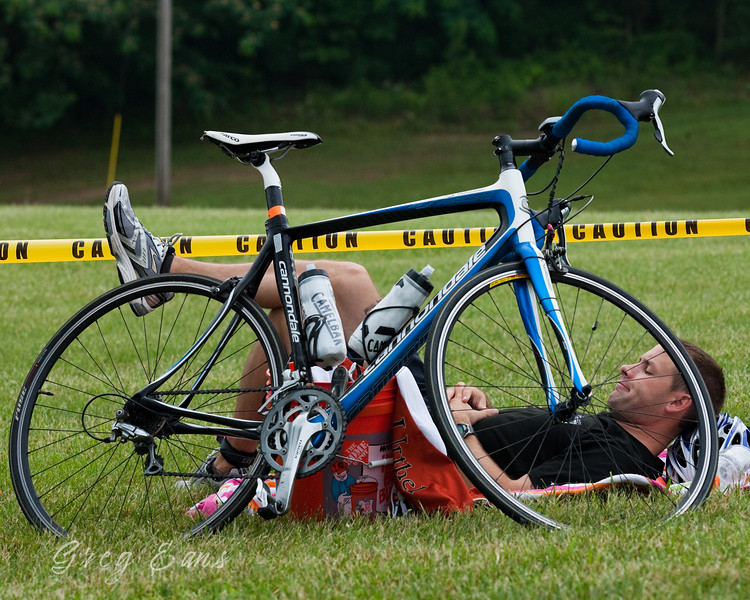 A biker takes a rest before participating in the Lakewood Valley Triathlon in Winterville, KY. 2010.