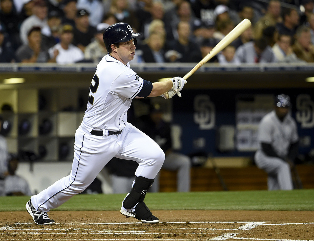 . SAN DIEGO, CA - APRIL 15:  Jedd Gyorko of the San Diego Padres hits an RBI single during the first inning of a  baseball game against the Colorado Rockies at Petco Park April 15, 2014 in San Diego, California. All uniformed team members are wearing jersey number 42 in honor of Jackie Robinson Day.  (Photo by Denis Poroy/Getty Images)