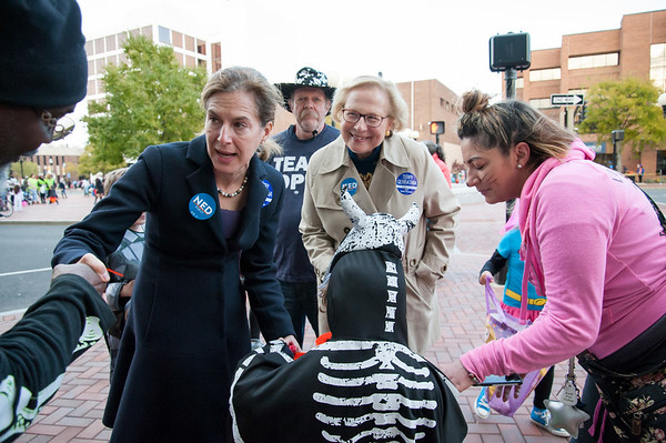 10/31/18 Wesley Bunnell | Staff Democratic candidate for Lt. Governor Susan Bysiewicz, and State Senator Terry Gerratana pass out candy to Paul Neal, far L, Mason Wollschlager, age 4, and Mason's mother Brittany Vargas , R, during New Britain's annual Halloween Safe Zone event on Halloween night.