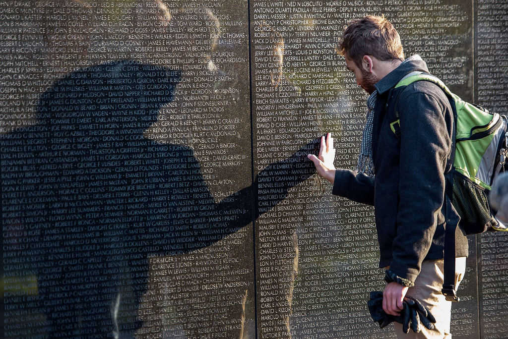 . An unidentified man is seen touching the Viet Nam Memorial wall on Veteran\'s Day November 11, 2013  as he pays his respects to fallen veterans in Washington, DC.    PAUL J. RICHARDS/AFP/Getty Images