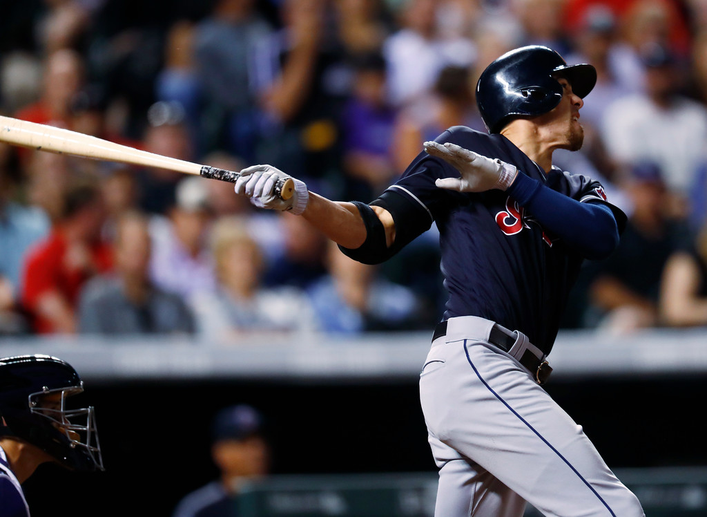 . Cleveland Indians\' Bradley Zimmer follows the flight of his two-run home run off Colorado Rockies starting pitcher Antonio Senzatela in the seventh inning of an interleague baseball game Tuesday, June 6, 2017, in Denver. The Rockies won 11-3. (AP Photo/David Zalubowski)