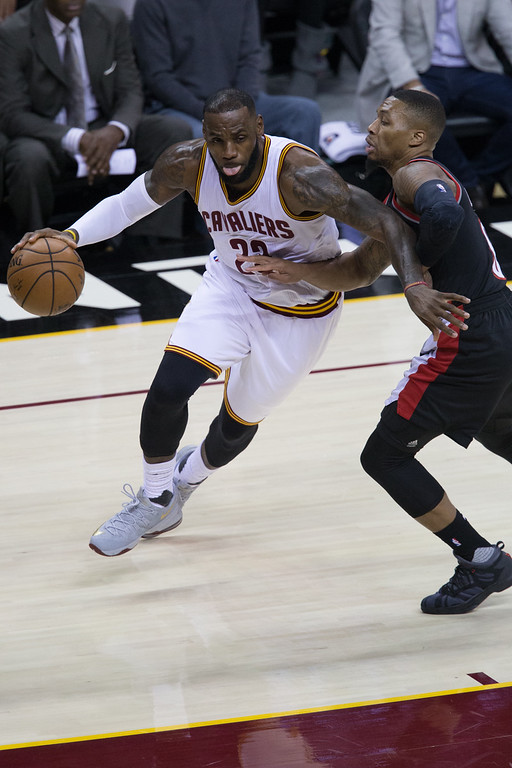 . Michael Johnson - The News-Herald Lebron James of the Cleveland Cavaliers (23) drives by Damian Lillard  during a home game against the Portland Trailblazers on November 23, 2016 at the Quicken Loans Arena.