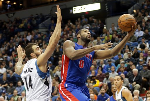 . Detroit Pistons\' Andre Drummond lays up as Minnesota Timberwolves\' Nikola Pekovic of Montenegro defends in the second half of an NBA basketball game, Thursday, Oct. 30, 2014, in Minneapolis. The Timberwolves won 97-91. (AP Photo/Jim Mone)