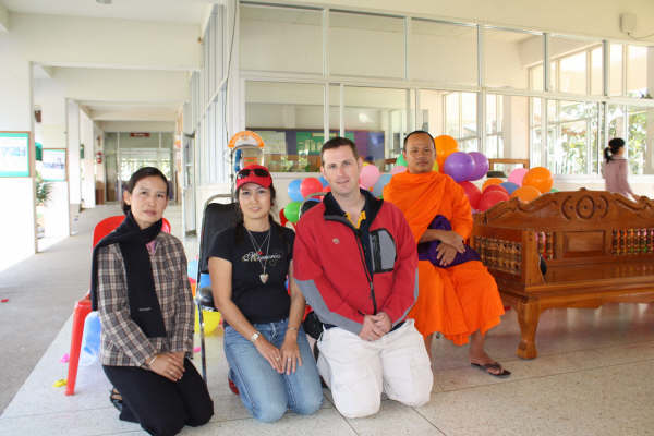 Posing with a monk that was there to do a blessing
