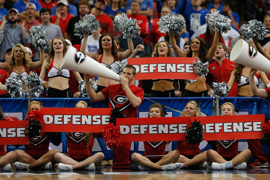 . Georgia Bulldogs cheerleaders perform during the semifinals of the SEC Men\'s Basketball Tournament against the Kentucky Wildcats at Georgia Dome on March 15, 2014 in Atlanta, Georgia.  (Photo by Kevin C. Cox/Getty Images)