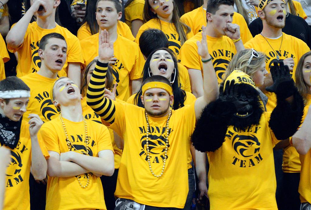 . Duncan Scott/DScott@News-Herald.com Riverside\'s Money Team celebrates a basket during Riverside\'s 49-43 victory over Chardon Friday night.