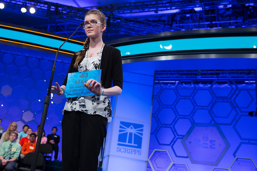 ". Mary Horton, 13, of West Melbourne, Fla., spells the word ""logodaedaly\"" correctly during the final round of the National Spelling Bee, on Thursday, May 29, 2014, in Oxon Hill, Md. (AP Photo/Evan Vucci)"