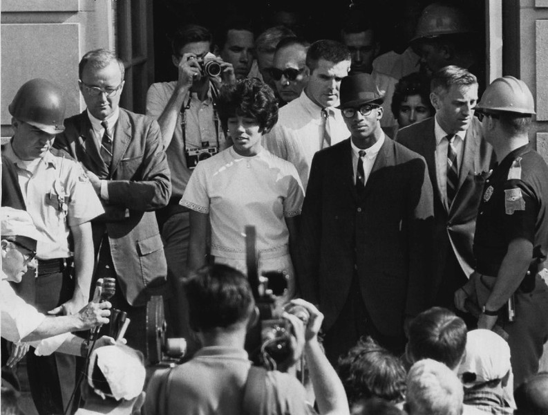 . Vivian Malone and James Hood enter University of Alabama in 1963. Miss Malone received bachelor of science degree, but Hood dropped out in summer 1963.