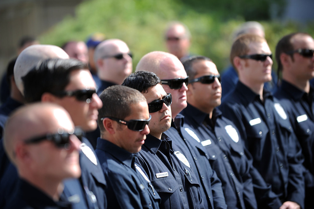 . Firefighters look on during the 20th Anniversary Memorial Ceremony for firefighter Jeff Langley March 28, 2013 at the Los Angeles County Fire Department Barton Heliport in Pacoima, CA.  Langley was killed during a 1993 Air Operations rescue in Malibu.(Andy Holzman/Staff Photographer)