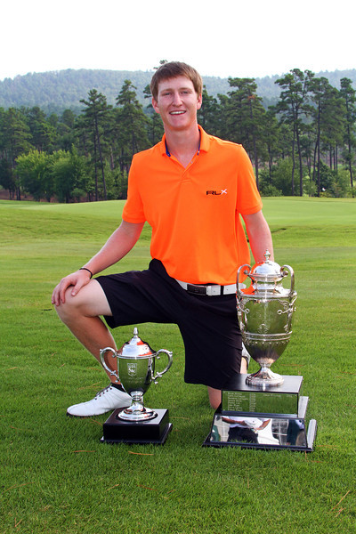 Jordan Niebrugge poses with his personal trophy and the George R. Thorne trophy at the conclusion of the 111th Western Amateur at The Alotian Club in Roland, AR. (WGA Photo/Ian Yelton)