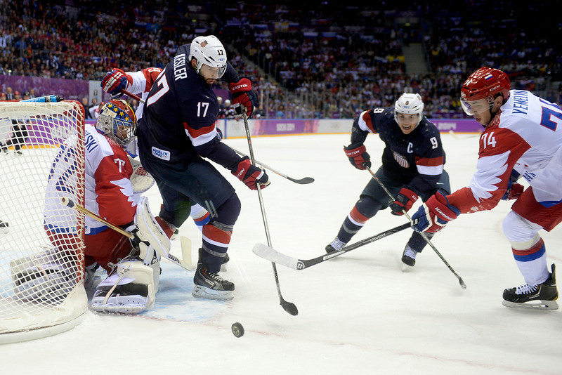 . Ryan Kesler (17) of the U.S.A. cannot quite take a shot as Sergei Bobrovski (72) of the Russia defends during the first period of men\'s hockey action at Bolshoy arena. Sochi 2014 Winter Olympics on Saturday, February 15, 2014. (Photo by AAron Ontiveroz/The Denver Post)