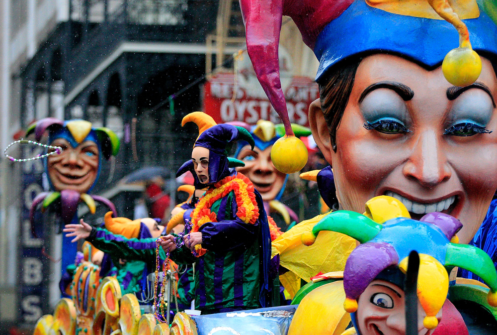 Description of . Members of Rex parade down St. Charles Avenue despite the rain Mardi Gras Day on March 4, 2014 in New Orleans, Louisiana. Fat Tuesday, the traditional celebration on the day before Ash Wednesday and the beginning of Lent, is marked in New Orleans with parades and marches through many neighborhoods in the city.(Photo by Sean Gardner/Getty Images)