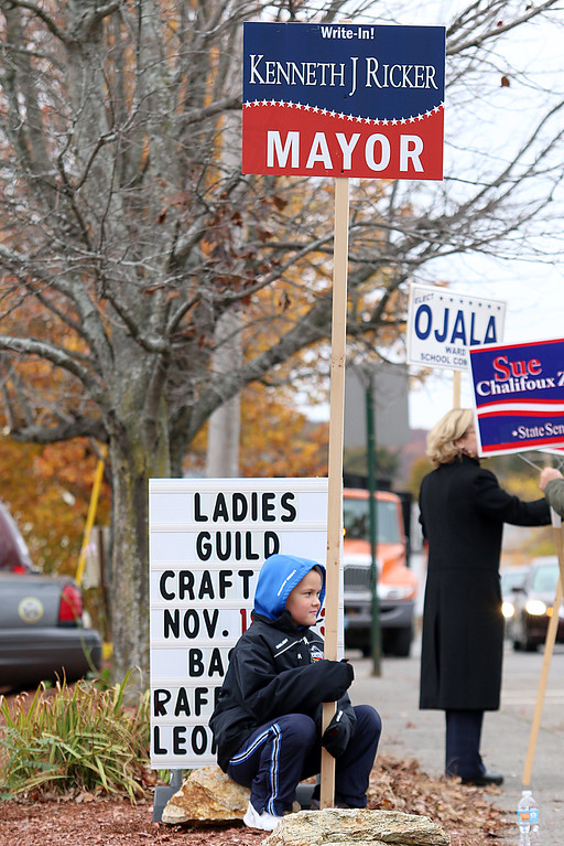 . Maxwell Crossman, 7, of Leominster got a little tired while holding a sign for candidate for mayor Kenneth Ricker outside the polls at the Veterans\' Center in Leominster on Tuesday afternoon. SENTIENL & ENTERPRISE/JOHN LOVE