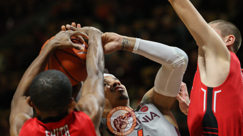 Seth Allen is double teamed and fouled in the second half on a layup attempt. (Mark Umansky/TheKeyPlay.com)