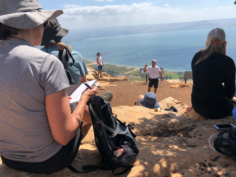 Rod teaching from the top of the mountain with the Sea of Galilee making the lesson even more epic..jpeg