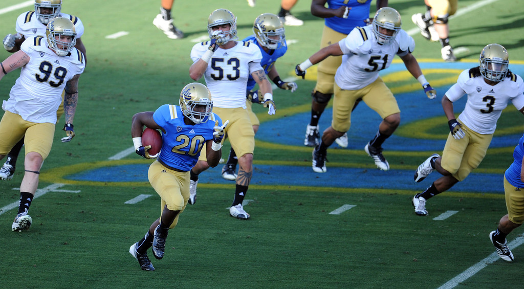 . UCLA running back Melvin Emesibe (20) runs for yardage during the football spring showcase college football game in the Rose Bowl on Saturday, April 27, 2013 in Pasadena, Calif.    (Keith Birmingham Pasadena Star-News)