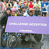 Wheelchair competitors proudly display their MosRehab Challenge Accepted sign. MossRehab sponsored the Global Abilities team.