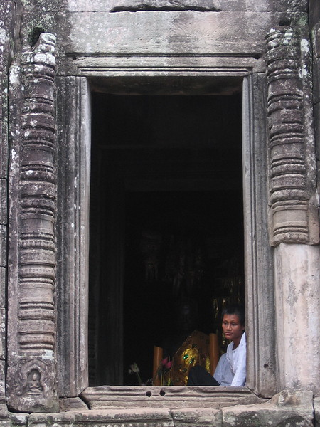 Peering out a temple window