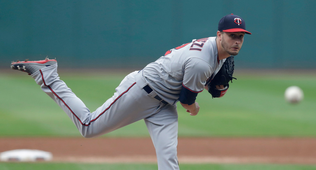 . Minnesota Twins starting pitcher Jake Odorizzi watches a throw during the first inning of a baseball game against the Cleveland Indians, Wednesday, Aug. 8, 2018, in Cleveland. (AP Photo/Tony Dejak)