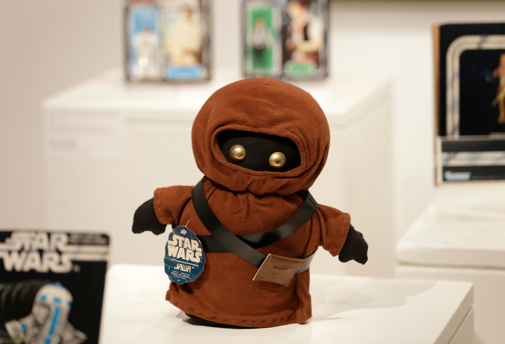 . Toys and other memorabilia from the \'Star Wars\' movie series are displayed during a press preview at Sotheby\'s in New York, Wednesday, Dec. 2, 2015. Sotheby\'s is holding an online auction of hundreds of rare and original objects associated with the space odyssey series. (AP Photo/Seth Wenig)