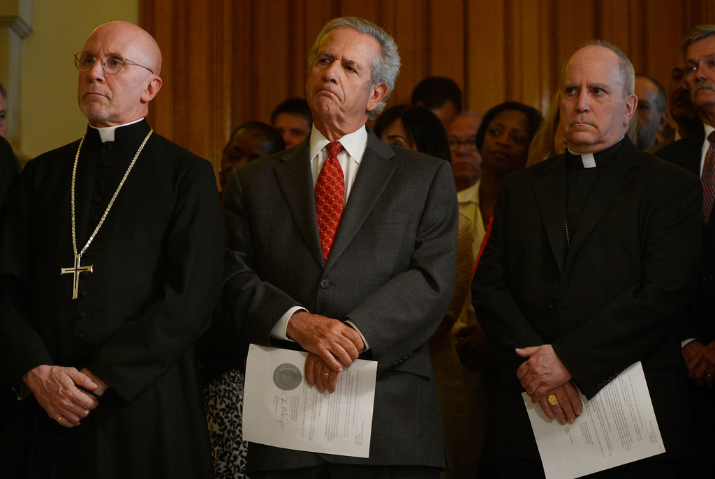 ". DENVER, CO. - MAY 21: (l-r) The Very Rev. Peter Eaton, Dean of Saint John\'s Episcopal Cathedral, Rabbi Steven Foster and Roman Catholic Archbishop Samuel J. Aquila listen to comments from Gov. John Hickenlooper during a press conference at the capitol in Denver, CO May 21, 2013. Hickenlooper issued an executive order granting convicted killer Nathan Dunlap a ""temporary reprieve\"" from an execution that had been just three months away. (Photo By Craig F. Walker/The Denver Post)"