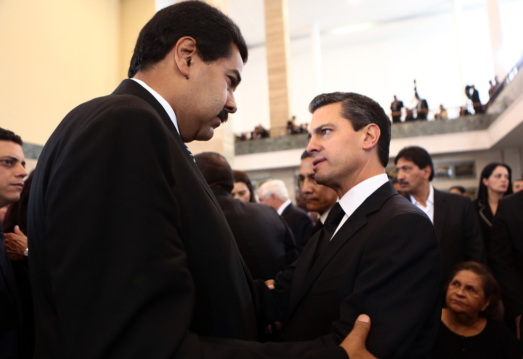 . This handout picture released by Venezuelan presidency press office shows Mexican President Enrique Pena Nieto offering his condolences to Venezuelan vice President Nicolas Maduro during the funeral of late Venezuelan President Hugo Chavez in Caracas, on March 8, 2013. AFP PHOTO/PRESIDENCIA/MARCELO GARCIA / Miguel Angel Angul/AFP/Getty Images