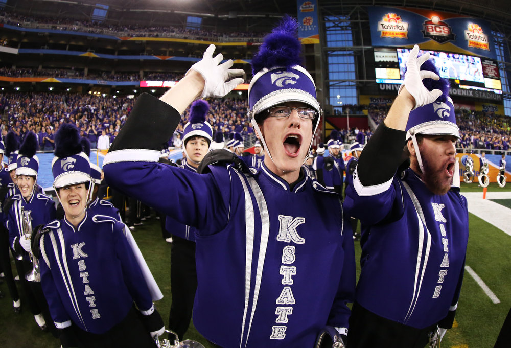 . Members of the Kansas State Wildcats marching band warm up prior to their game against the Oregon Ducks in the Tostitos Fiesta Bowl at University of Phoenix Stadium on January 3, 2013 in Glendale, Arizona.  (Photo by Stephen Dunn/Getty Images)