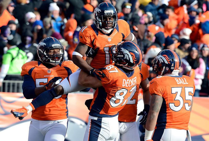 . Denver Broncos wide receiver Trindon Holliday (11) celebrates with teammates after scoring a touchdown on an 89 yard punt return early in the first quarter.  The Denver Broncos vs Baltimore Ravens AFC Divisional playoff game at Sports Authority Field Saturday January 12, 2013. (Photo by John Leyba,/The Denver Post)