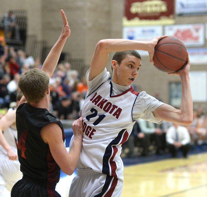 . LITTLETON, CO. - JANUARY 17: Eagles\' point Ian MacDonald secured a rebound in the second half. The Dakota Ridge High School boy\'s basketball team hung on to beat Chatfield 53-51 Friday night, January 17, 2014. Photo By Karl Gehring/The Denver Post