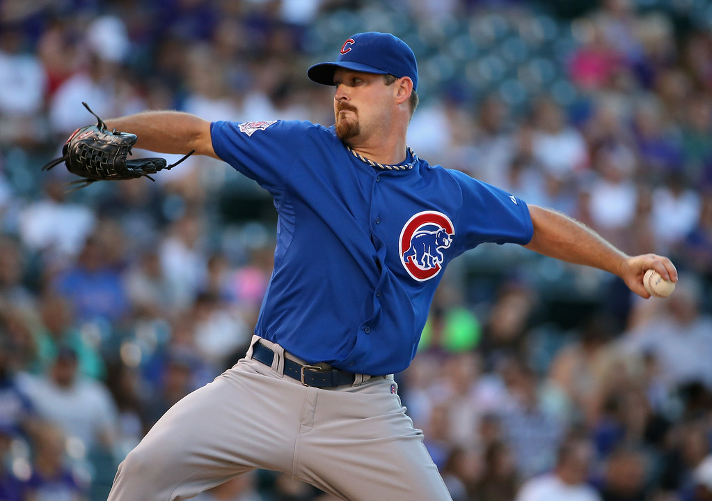 . DENVER, CO - AUGUST 05:  Starting pitcher Travis Wood #37 of the Chicago Cubs delivers against the Colorado Rockies at Coors Field on August 5, 2014 in Denver, Colorado.  (Photo by Doug Pensinger/Getty Images)