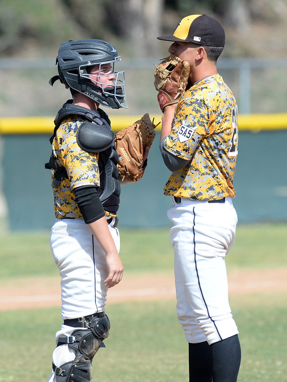 . Santa Fe catcher Cameron Velasco (#140 talks with pitcher Eddie Fournier (#21) as they play La Serna in their Del Rio League game at La Serna High School in Whittier on Wednesday April 23, 2014. (Staff Photo by Keith Durflinger/Whittier Daily News)