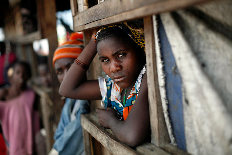 . An internally displaced Congolese  woman waits for food to be distributed by WFP at the Mugunga 3 camp outside the eastern Congolese town of Goma Sunday Dec. 2, 2012. Rebels say they will take back Congo\'s city of Goma if the government does not agree to negotiate with them by Monday. The M23 rebels completed their withdrawal of the eastern Congo city on Saturday, in compliance with an agreement reached between the rebel group and a regional body. (AP Photo/Jerome Delay)