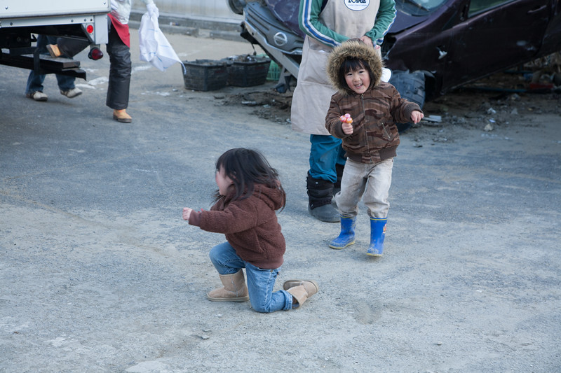 These kids are happily playing in spite of the hard ship brought by the natural disaster.