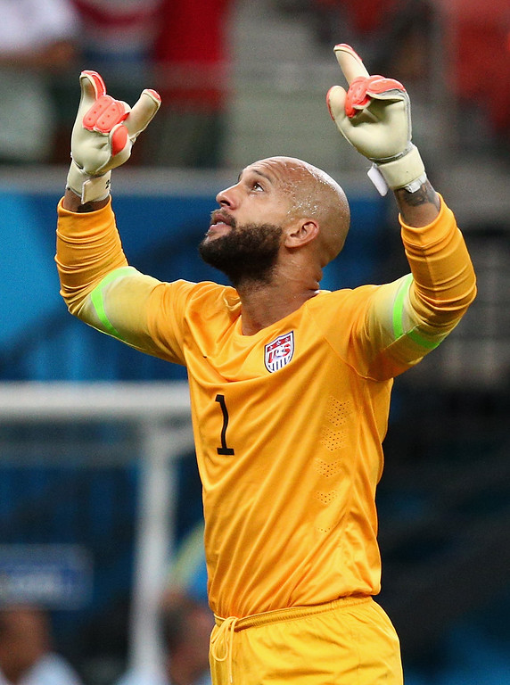 . Goalkeeper Tim Howard of the United States celebrates his team\'s first goal during the 2014 FIFA World Cup Brazil Group G match between the United States and Portugal at Arena Amazonia on June 22, 2014 in Manaus, Brazil.  (Photo by Adam Pretty/Getty Images)