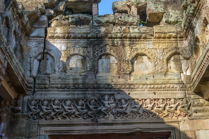 PREAH KHAN. Buddha images removed in the upper portion of this pediment? Lots of dancing apsaras in the lower portion!