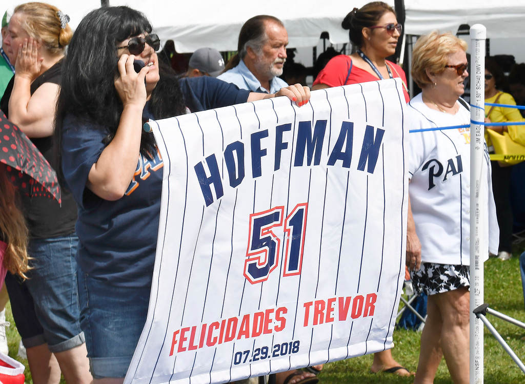 . Trevor Hoffman fan Rocio Hodges, of Chula Vista, Calif., uses a banner to find her husband before the start of National Baseball Hall of Fame induction ceremonies on Sunday, July 29, 2018, in Cooperstown, N.Y. (AP Photo/Hans Pennink)