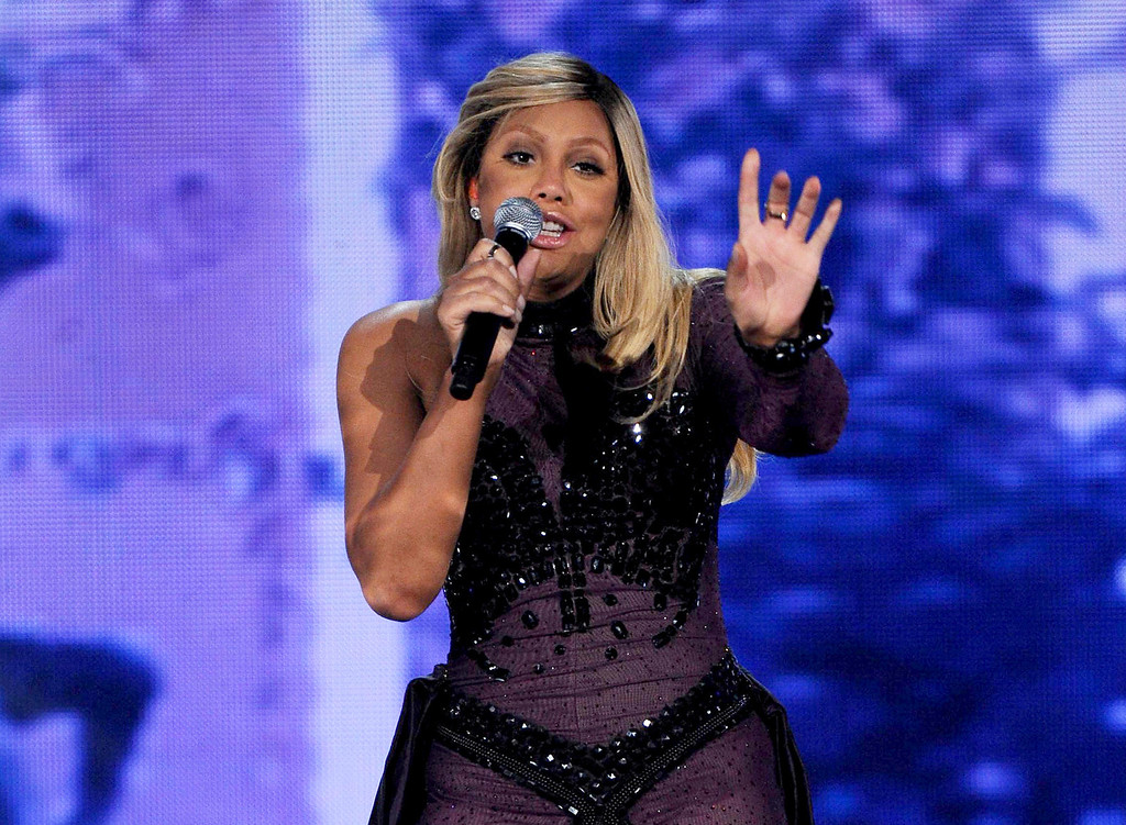 """. FILE - This Nov. 8, 2013 file photo shows Tamar Braxton performing at the 2013 Soul Train Awards at the Orleans Arena in Las Vegas. Braxton is nominated for three honors at Sunday\'s Grammy Awards, including best urban contemporary album for her first album in 13 years, \""""Love and War.\"""" The title track is also nominated for best R&B song and R&B performance. (Photo by Frank Micelotta/Invision/AP, File)"""