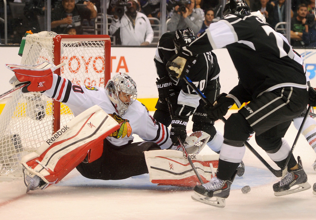 . Blackhawks goalie Corey Crawford stops a shot by the Kings\' Jeff Carter during game six of the Western Conference Finals, Friday, May 30, 2014, at Staples Center. (Photo by Michael Owen Baker/Los Angeles Daily News)