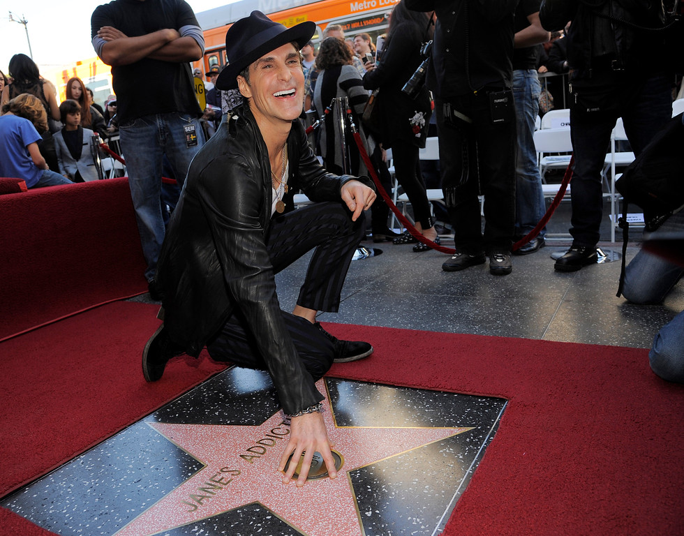 . Perry Farrell, lead singer for the rock band Jane\'s Addiction, poses atop the band\'s new star on the Hollywood Walk of Fame on Wednesday, Oct. 30, 2013 in Los Angeles. (Photo by Chris Pizzello/Invision/AP)