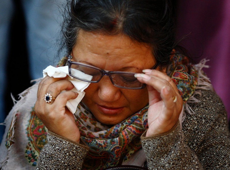 ". A Tibetan woman wipes her tears during a function organized at the Tibetan monastery in Boudhanath Stupa to mark the third day of New Year or ""Losar\"" celebration in Kathmandu February 13, 2013. A Tibetan monk self-immolated today at the premises of the Boudhanath Stupa. REUTERS/Navesh Chitrakar"