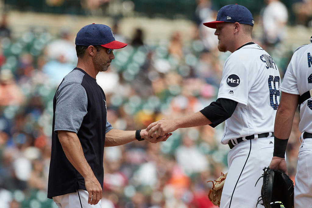 . Detroit Tigers manager Brad Ausmus takes the ball to relieve relief pitcher Daniel Stumpf (68) during the seventh inning against the Cleveland Indians in the first baseball game of a doubleheader in Detroit, Saturday, July 1, 2017. (AP Photo/Rick Osentoski)