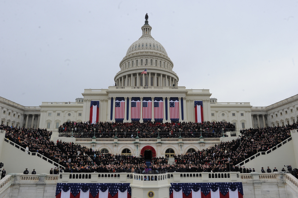 Description of . US President Barack Obama takes the oath of office during the 57th Presidential Inauguration ceremonial swearing-in at the US Capitol on January 21, 2013 in Washington, DC. JEWEL SAMAD/AFP/Getty Images