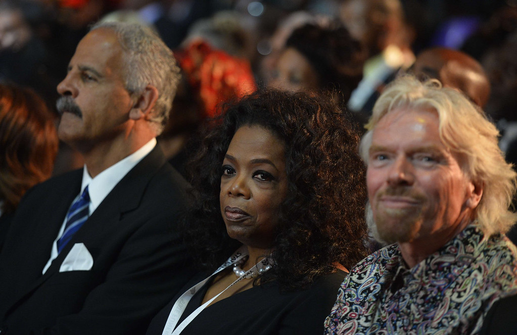 . British entrepreneur Richard Branson (R) and US TV host Oprah Winfrey attend the funeral ceremony of South African former president Nelson Mandela in Qunu on December 15, 2013. Mandela, the revered icon of the anti-apartheid struggle in South Africa and one of the towering political figures of the 20th century, died in Johannesburg on December 5 at age 95.  AFP PHOTO / POOL / ODD ANDERSENODD ANDERSEN/AFP/Getty Images