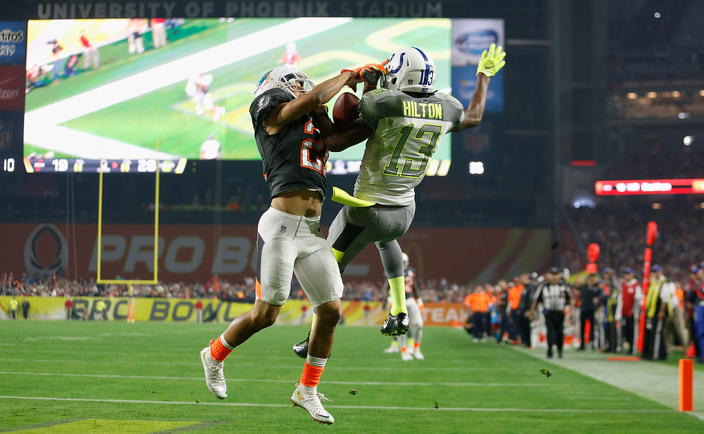 . GLENDALE, AZ - JANUARY 25:  Team Irvin cornerback Brent Grimes #21 of the Miami Dolphins intercepts a pass over Team Carter wide receiver T.Y. Hilton #13 of the Indianapolis Colts during the third quarter of the 2015 Pro Bowl at University of Phoenix Stadium on January 25, 2015 in Glendale, Arizona.  (Photo by Christian Petersen/Getty Images)
