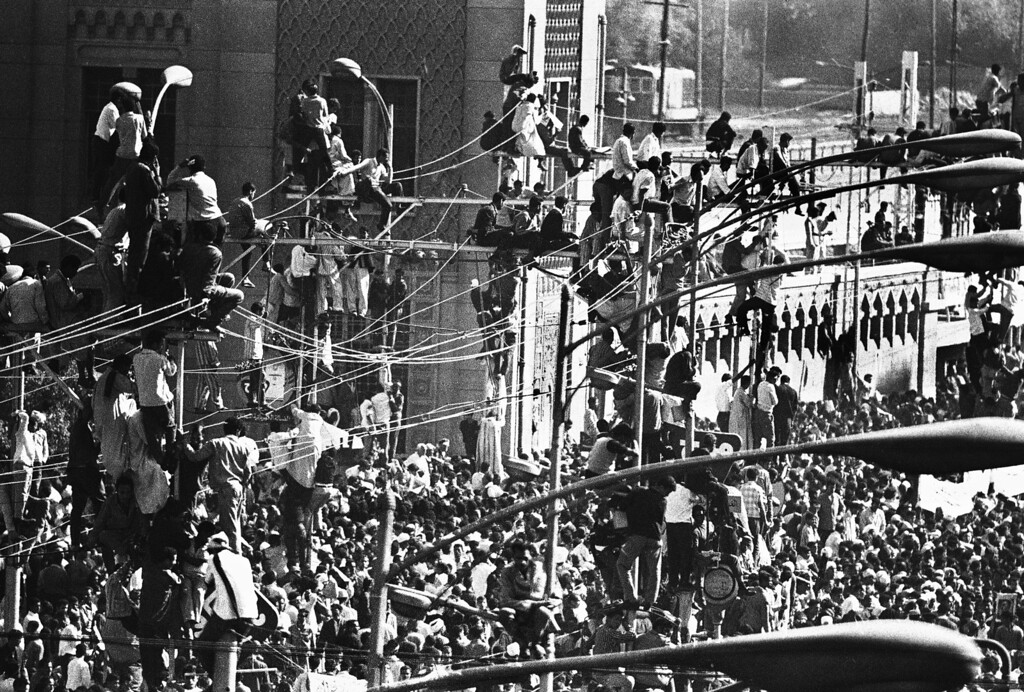 . Egyptians crowd the tops of telegraph poles in Cairo, Egypt on Oct. 1, 1970, for a grandstand view of President Gamal Abdel Nasserís funeral procession. (AP Photo/Eddie Adams)