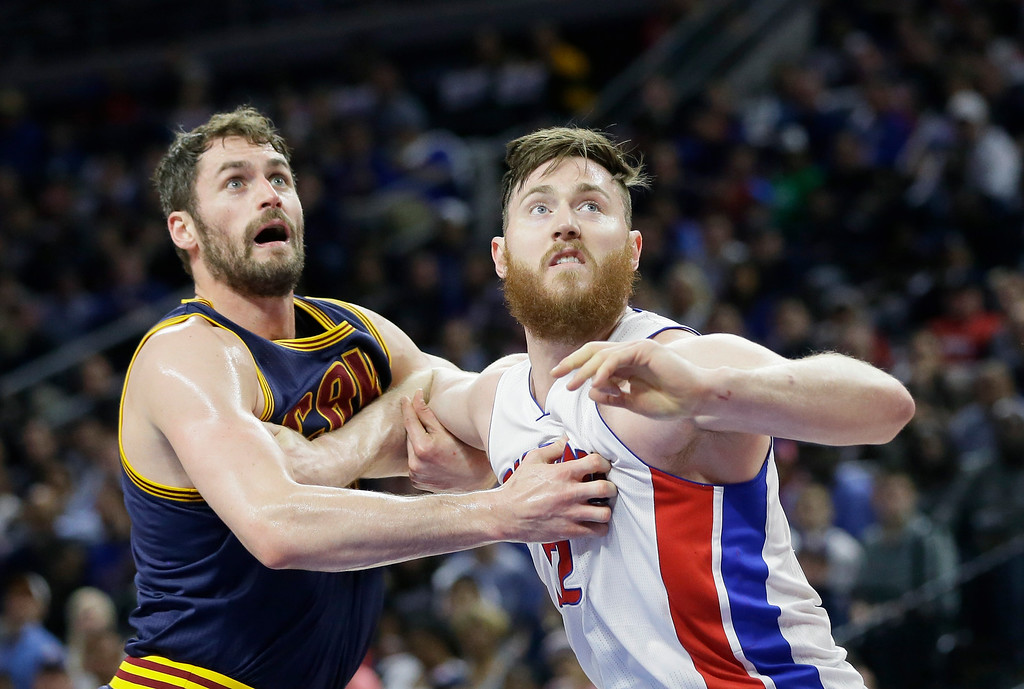 . Cleveland Cavaliers forward Kevin Love, left, and Detroit Pistons center Aron Baynes battle for the rebound during the first half in Game 4 of a first-round NBA basketball playoff series, Sunday, April 24, 2016 in Auburn Hills, Mich. (AP Photo/Carlos Osorio)
