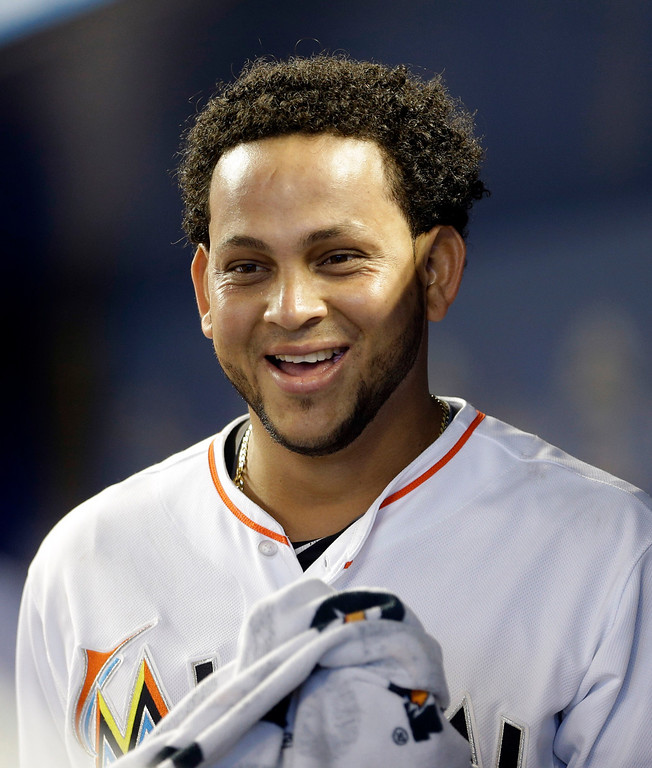 . Miami Marlins\' Henderson Alvarez smiles in the dugout during the bottom of the ninth inning of an interleague baseball game against the Detroit Tigers, Sunday, Sept. 29, 2013, in Miami. Alvarez pitched a no-hitter as the Marlins won 1-0. (AP Photo/Alan Diaz)