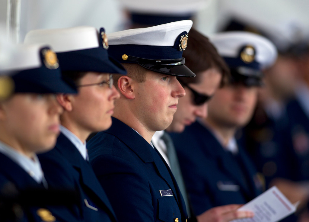 . U.S. Coast Guard personnel listen to a memorial service for Boatswain\'s Mate Third Class Travis R. Obendorf, Thursday, Jan. 30, 2014 on Coast Guard Island in Alameda, Calif. Obendorf suffered fatal injuries while performing his duties aboard the Coast Guard Cutter Waesche as part of a search and rescue off the coast of the Alaska in November 2013. (D. Ross Cameron/Bay Area News Group)